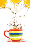 Three lemons, color cup and splash of tea Royalty Free Stock Images