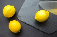 Three Lemons on Grey Surface Royalty Free Stock Image