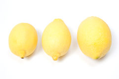 Three lemons, isolated on white Stock Photos