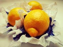 Three lemons on paper. Three ripe lemon on paper royalty free stock image