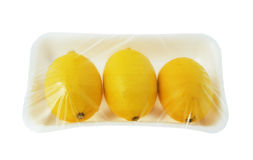 Three lemons in vacuum pack Stock Images