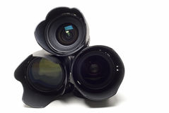 Three lenses for digital cameras. Royalty Free Stock Photo