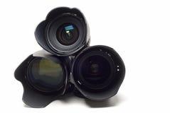 Three lenses for digital cameras. Royalty Free Stock Photo