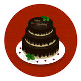 Three-level chocolate cake with the words Happy Birthday and cherries Royalty Free Stock Photos