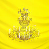 Three-level crystal chandelier with the burning candles on a yel Royalty Free Stock Images