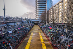 Three-level parking of bicycles in Amsterdam city centre. Stock Images