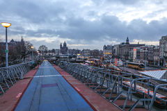 Three-level parking of bicycles in Amsterdam city centre. Stock Photos