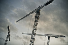 Three lifting cranes Stock Photo