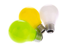 Three light bulbs. In green yellow and white Royalty Free Stock Image