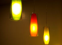 Three light bulbs. With all the illumination light into dark corners Royalty Free Stock Photography