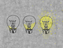Three light bulbs. Filled with light drawing on wall Royalty Free Stock Photos
