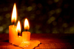 Three light candle burning Stock Images
