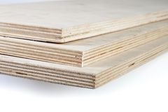 Three light plywood boards stacked Royalty Free Stock Images