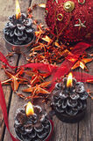 Three lighted Christmas candles Royalty Free Stock Photo