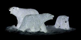 Three lighted figures Stock Image