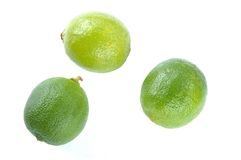 Three limes. Three green limes on white background Royalty Free Stock Images