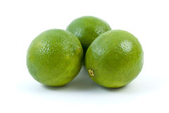 Three limes. Isolated on the white background Royalty Free Stock Photos