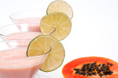 Three limes and nonalcoholic fruit cocktail Stock Photos