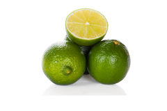 Three limes  on white Stock Image