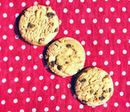 Three lined up chocolate chip cookies Royalty Free Stock Images