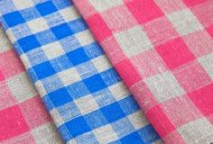 Three linen table napkins. Background Royalty Free Stock Photos