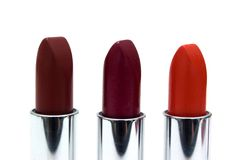 Three lipsticks. Isolated on a white background Stock Image
