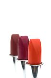Three lipsticks. Isolated on a white background Royalty Free Stock Photos