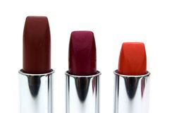 Three lipsticks. Isolated on a white background Stock Photography