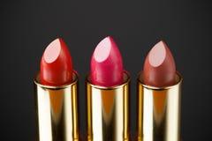 Three lipsticks Stock Photography