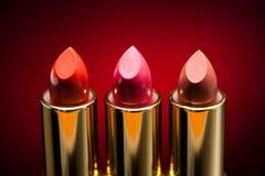 Three lipsticks Stock Photos
