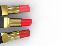 Three lipsticks Stock Images