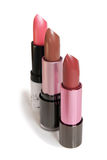 Three lipsticks with different colors  Royalty Free Stock Photography