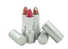 Three lipsticks isolated on white background Stock Photos