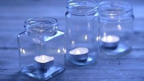 Three lit candles stock video footage