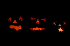 Three lit jack o-lanterns Stock Photo