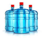 Three 19 liter or 5 gallon plastic drink water bottles Stock Photography
