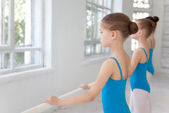 Three little ballet girls posing together Stock Photos