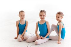 Three little ballet girls sitting and posing together Royalty Free Stock Photography
