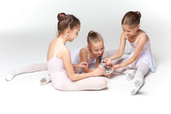 Three little ballet girls sitting and posing together Stock Photography