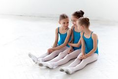 Three little ballet girls sitting and talking together Stock Photo