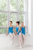Three little ballet girls standing and talking together Stock Photography