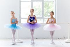 Three little ballet girls in tutu and posing together Royalty Free Stock Photo