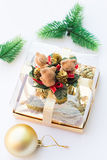 Three Little Bears Present and a Christmas Tree Ball. Three Little Bears Present and a Golden Christmas Tree Ball Isolated on White Royalty Free Stock Photos