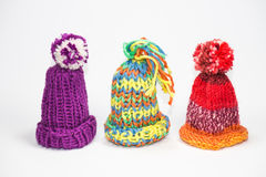 Three little bobble hats. Three knitted bobble caps using for egg cozy and warmer Stock Image