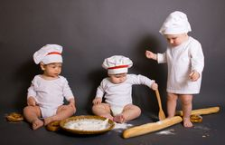 Three little boy cook Royalty Free Stock Image