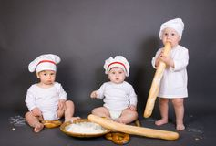 Three little boy cook Royalty Free Stock Photos