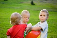 Three little boy play with ball Royalty Free Stock Photos