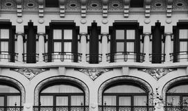 The three little boys on the cover. Shot and black and white, detail on the sculpture on the facade of this historic building representing some plants / flowers Stock Image