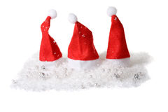 Three little christmas hats Stock Images