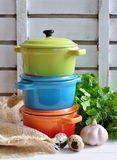 Three  little colorful cooking pots, eggs and garlic Royalty Free Stock Photo